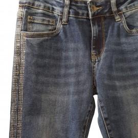 Jean slim bleu à bande en strass